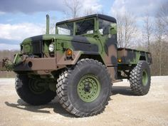 This is a bobbed deuce and a half. It'll go anywhere, smash, push, or tow anything, and it'll run on gas, diesel, or kerosene.