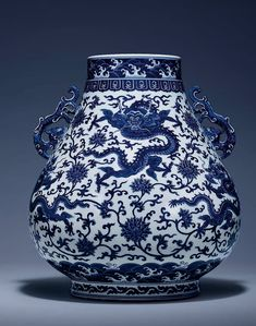 A magnificent and fine blue and white 'Dragon' hu-shaped vase, Qianlong six-character archaistic seal mark and of...