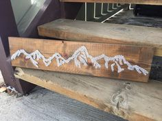 The mountains are calling & I must go!  The beautiful Teton Mountain ranges are displayed on this rustic pine wood. Every mountain lover or ski house or family cabin will pop with this in its presence! This is a stained dark walnut board, 7 inches by 3 ft long with white stringing. Please message in the color of string and whether you want the board stained or painted a color. ***Note: nails can come in silver or gold.