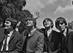 The Beatles shy waving to enthusiastic teenagers along Amsterdam canal - Reuters