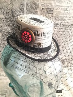 Available on etsy.com/shop/arcaniumdesign : Steampunk Mini Top Hat Fascinator - Newsprint with Red LED Porthole