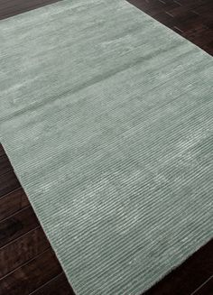 """The concept of the solid rug is redefined with the Basis Collection. Hand-loomed in rich wool and art silk, a sophisticated sheen and subtle gradation of color gives each piece a unique depth.  Catalog Code: BI08  Design: Basis  Color: Silver Sea Moss  Construction: Hand Loom  Backing: No  Pile Height: 1/4"""""""