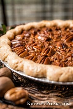 Homemade buttery crust filled with caramelized Royalty Pecans in a rich, delicious filling enhanced with