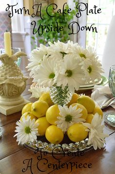 Inverted cake plate as a vase and base! How clever! A Summer Tablescape of Lemons and Daisies