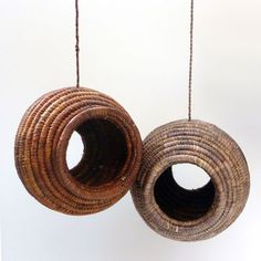 """This birdhouse, which is intended to be sold in """"fair trade"""" shops, is designed as a way to assist Ugandan producers of raffia goods. It is made in the same way as traditional Ugandan baskets. A long sheaf of millet blades is wrapped in raffia to make rope-like structure, which is then wound spirally into a sphere. The birdhouse is made entirely from natural materials, which can be colored with natural dyes; in this way, too, patterns can be added to the birdhouse.  igreenspot.com"""
