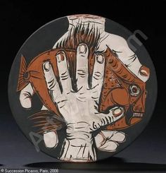 Picasso's hands with fish plate