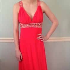 Dress Long Fluorescent pink dress with rhinestones on under chest and on the upper back. Paid $455 and will be happy to negotiate on the price! Dresses Prom