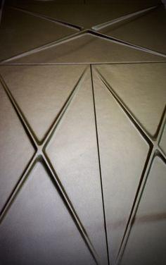 Harcourt London :  Cast leather tiles.