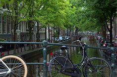 amsterdam canals with bicycles of course
