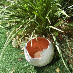 The inside of the concrete sphere was sprayed with Rust-Oleum copper metallic spray paint.