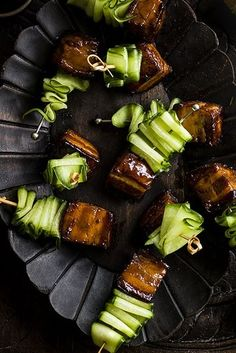 CARAMELIZED LIME GINGER PORK BELLY & CUCUMBER RIBBON SKEWER [Vietnam] [olivemagazine] [plating, service, presentation]