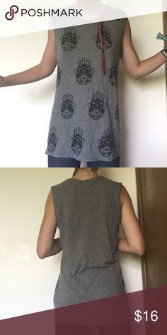 Hamsa Grey Brandy Melville Muscle Shirt This awesome Brandy Melville Muscle Tank has cool hamsas all over the front. The back is blank. It's a light grey material that breathes well. Lightly worn but in superb condition. Can be worn like a little dress with safety shorts, or with pants or bell bottoms for example. A super cute easy outfit. Brandy Melville Tops Muscle Tees