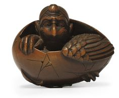 A WOOD NETSUKE  SIGNED 'SHUMIN' EDO PERIOD, 19TH CENTURY  Of a Tengu emerging from an egg, stained ring himatoshi. Christie's.