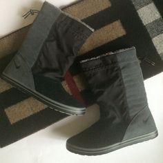 NWOT*Nike Boots, Size 9 Never used. Mid-calf boot. Soft inside. Elastic band for adjustable calf sizes. Lightweight, thin soles provide a gym shoe type feel. Size 9. Nike Shoes
