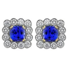 6.34 Carat Tanzanite Diamond Platinum Cluster Earrings | From a unique collection of vintage lever-back earrings at https://www.1stdibs.com/jewelry/earrings/lever-back-earrings/