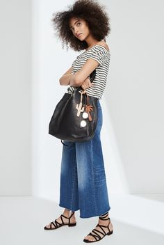 8d3c11fd8fc madewell wide-leg crop jeans worn with the striped melody off-the-shoulder