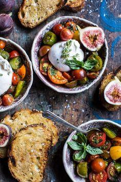 Marinated cherry tomatoes with burrata and toast.