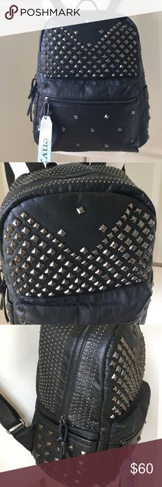 Envy Backpack Rock Stud faux leather 13X11X6.5 D. 2 slip and 1 zipper pocket inside. Outside has side pockets and 2 zipper compartments. Envy Bags Backpacks