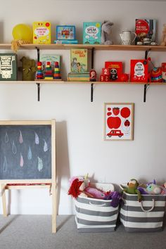 Organized play area in kids bedroom. - SHELVES. I think perhaps some high shelves might be the way to go for a while.