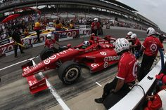 Dario Franchitti of Scotland, drives the #50 Target Chip Ganassi Racing Dallara Honda in the IZOD Pit Stop Challenge at Indianapolis Motor Speedway on May 25, 2012 in Indianapolis, Indiana.