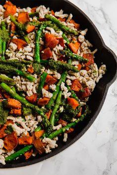 This asparagus, turkey and sweet potato skillet is a simple one-pan meal full of spring flavors, and topped with a herbaceous pesto. It's paleo, whole30, and AIP.