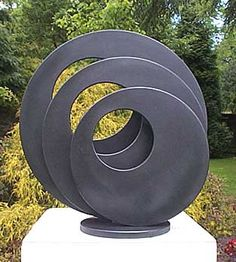 Garden Sculpture: Three Circles with Holes. 600mm diameter, fabricated steel, galvanised and painted for weather protection. Weight 55kg