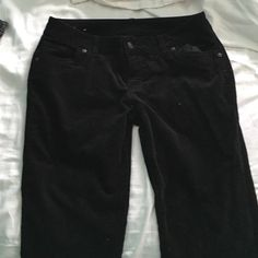 Black boot cut cords ONLY WORN ONCE, in perfect condition! These pants are great for work or school, and are super soft and comfy! They're also very wearable, and flattering! Delias Pants Boot Cut & Flare