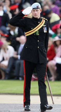 Rheass: So when are you getting married? Chelsea pensioner, 85, makes Prince Harry blush as Harry replies 'Not for a long time'