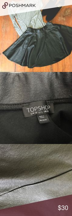 Vegan leather skirt from TOPSHOP Sexy vegan leather skirt from none other than TOPSHOP! Wonderfully soft on the inside, super edgy on the outside Topshop Skirts Circle & Skater