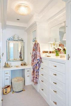 The feminine glam walk-in closet / dressing room of a Manhattan Beach house designed by Erin King. Take the full tour: http://www.sarahsarna.com/manhattan-beach-house/