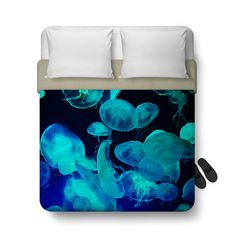 Sleep away in the wonders of the ocean deep when you wrap yourself up underneath this blue moon jellyfish duvet cover bed blanket throw! Available