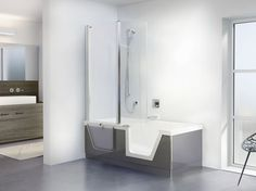 STEP-IN PURE DUSCHOLUX AG.Step-in Pure. is a Combination of bathtub & shower:  A rectangular tub with a large entry opening which is easily accessible.The white-translucent door is made of acrylic and is a functional and optical highlight of the flexible bath/shower unit. When bathing, the door with the raised handle element can be placed into the tub rim with one hand to guarantee that the tub is securely closed. Behind this there is a system with two processes and a unique locking system.