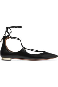 Immediately recognized by the sleek crossover ankle ties, Aquazzura's iconic 'Christy' flats are a cult classic. This timeless black style has been crafted in Italy from supple leather that's polished to a soft luster. A signature gold heel catches the light elegantly as you walk.