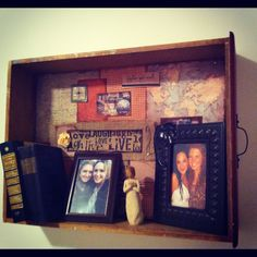 Old drawer repurposed as a shelf. Modge podge scrapbook paper to back