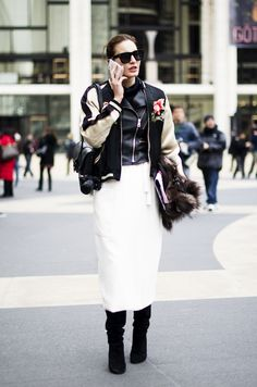 Who What Wear Blog 11 Ways To Style An Embroidered Bomber Jacket NYFW New York Fashion Week Street Style Oversized Sunglasses Leather Moto Jacket White Midi Skirt Knee High Suede Boots Ece Sukan Im Koo