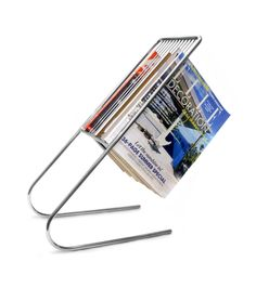 Floating Magazine rack.  I want this...even though I think my cat would pull the magazines down after long...still cool.