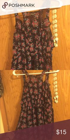 Cute floral top Super cute floral dressy tank, bottom part fits loosely. Size Medium, Express brand. Worn a few times but still in great condition! Express Tops Tank Tops