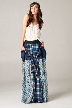 This blue toned plaid/flannel/vegan leather maxi skirt is perfect to reflect a boho vibe. It has a vegan leather waistband contrast with zipper closure in the back.  (70% POLYESTER, 25% COTTON, 5% P.U.) A Juju Janie Exclusive. Regular Price: $119.00 On Sale Until 11/1/14 Winner of the Fashi...