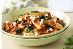 Spinach & Feta Bolognese This quick version of the classic has crumbled feta and wilted spinach for a modern twist.