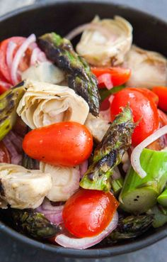 Asparagus Artichoke Salad! A light EASY springtime salad of grilled or roasted asparagus with marinated artichoke hearts and cherry tomatoes.