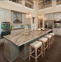 "Love the idea of having the 2nd floor railings be visible to from the kitchen as well as the traditional way it's done in The Great Room. Now that's a true ""open concept."""