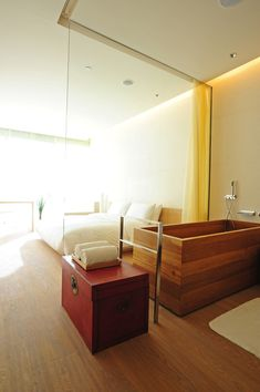 HOTEL: the opposite house, beijing. DESIGN: kango kama. CONCEPT: in keeping with the hotel's cool exterior, the 99 guest suites and rooms as well as a two-level penthouse blend modernity with tradition. each room designed with its natural wooden floors, king size down beds, and luxurious spa bathrooms.