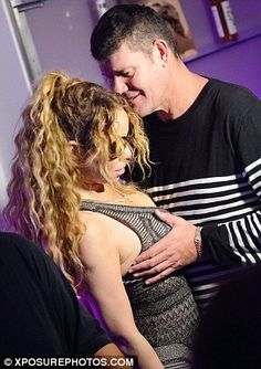 Touch My Body! Mariah Carey's billionaire fiancé James Packer can't keep their hands to themselves!