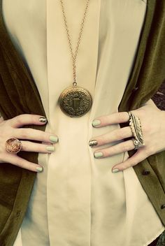 Great style/lifestyle blogger. But what is that gold nailpolish? I think the green might be Sinful Colors' Olympia from the ...(has something to do with sea, and the greek islands) collection.