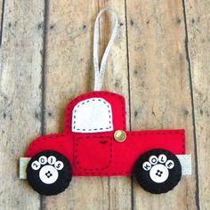Personalize your own felt truck Christmas ornament! Choose your wheel style and your favorite color add a name and its all about the zoom zoom! These little trucks are approximately 3 1/2 tall and 5 1/2 long and have a 3 ribbon hanger! Their wheels have buttons for centers, plain white for the boys and flowers for the girls should you have a truck loving girl! They are the most fuel efficient truck you will ever own with one of a kind customized white letter tires! Gently weighted and…