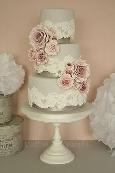 Grey wedding cake with lace and pink sugar flowers