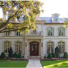 white brick house with beautiful trim!! love this home and materials...