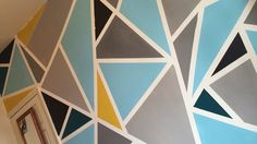 Geometric wall art. Done with Matt emulsion paint. Use painters tape - masking tape becomes loose.