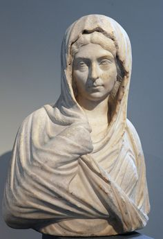 Marble Roman portrait of a woman who lived during the Severan period (ca. 193-211 CE) now in the Metropolitan Museum of Art in New York (inv. 30.11.11; Fletcher Fund).  She wears a hairstyle that is probably in imitation of Julia Domna, wife of the emperor Septimius Severus.  In the early third century portrait busts could include the upper torso of the body, including the arms and hands of the subject.