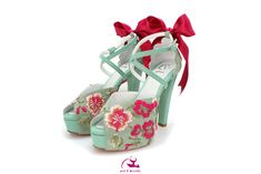 Custom made water green high heel shoe open toe with a double crossed ankle strap, a pink satin bow in the back of the shoe, the front shoe's skin decorated with flowers in embroidered lace and the back of the shoe as a shell.